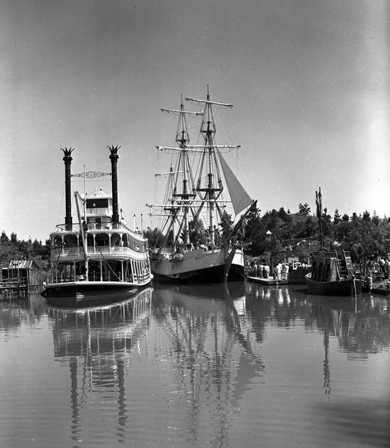 Sailing Ship Columbia Alongside the Mark Twain Riverboat at Disneyland Park in 1958