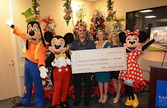 Elliot Mills, Vice President and General Manager, Aulani, a Disney Resort & Spa, Helps Present Donation to the Kapi`olani Health Foundation