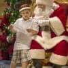 A Little Mouseketeer Reviewing His Christmas Wish List With Santa Claus