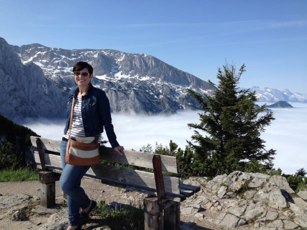 The author of this article is shown posing in front of the Bavarian Alps while vacationing with Adventures by Disney