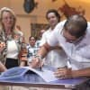 Pixar Animator Josh Cooley Signs a Panel of Disney's Art of Animation Resort's Storyboard Chandelier
