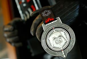 The Dark Side Medal Featuring the Emperor on one Side and Darth Vader on the Other