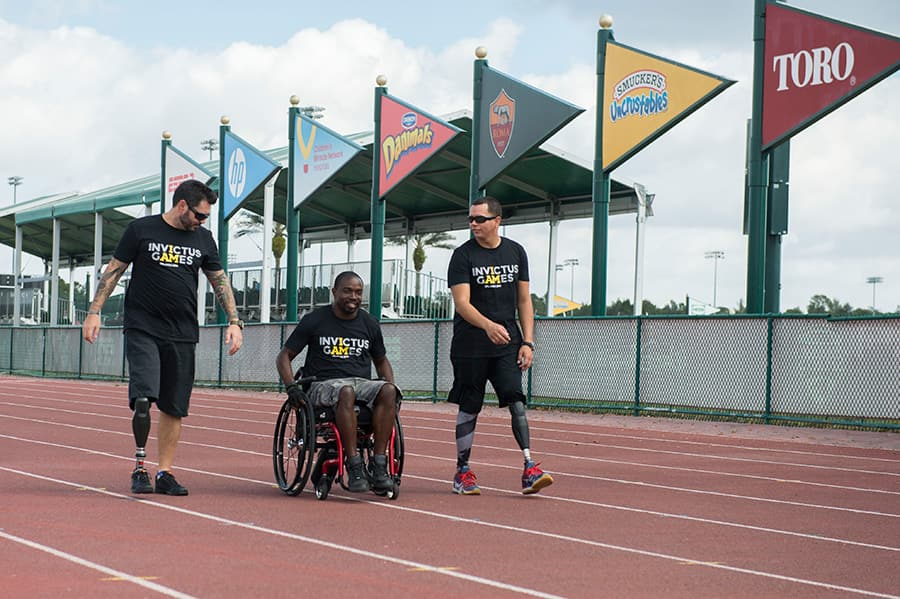 Invictus Games Competitors Retired Chief Petty Officer Javier Rodriguez (U.S. Navy) of Orlando, retired Petty Officer 3rd Class Henry Sawyer (U.S. Navy) of Callahan, Fla. (near Jacksonville) and Private Paul Warren (Australian Army) at the ESPN Wide World of Sports Complex at Walt Disney World Resort