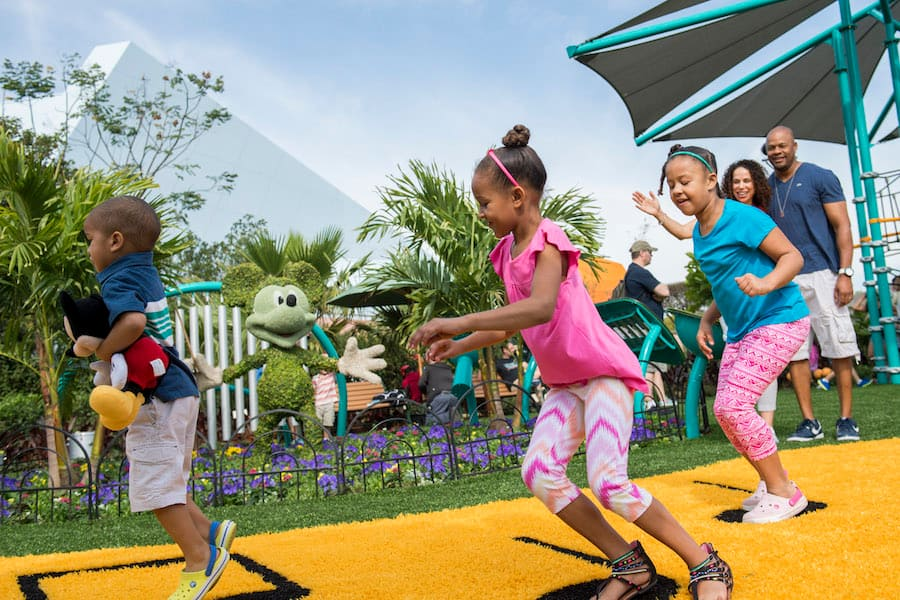 Guests play and make music with favorite Disney characters at Music Garden Melodies in Future World near Test Track during the Epcot International Flower & Garden Festival. The festival, which runs 90 days March 2-May 30, 2016 at Walt Disney World Resort in Lake Buena Vista, Fla., features dozens of character topiaries, stunning floral displays, gardening seminars and the Garden Rocks concert series - all included in regular Epcot admission. (Chloe Rice, photographer)