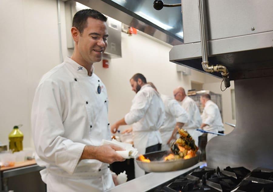 Chef Tim Majoras cooking at the Flying Fish Restaurant at Disney's Boardwalk at Walt Disney World Resort
