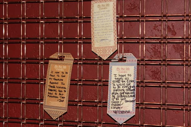 Personalized Tags Featuring Stories of Animals and Travel from Guests Hang in the Nomad Lounge at Disney's Animal Kingdom