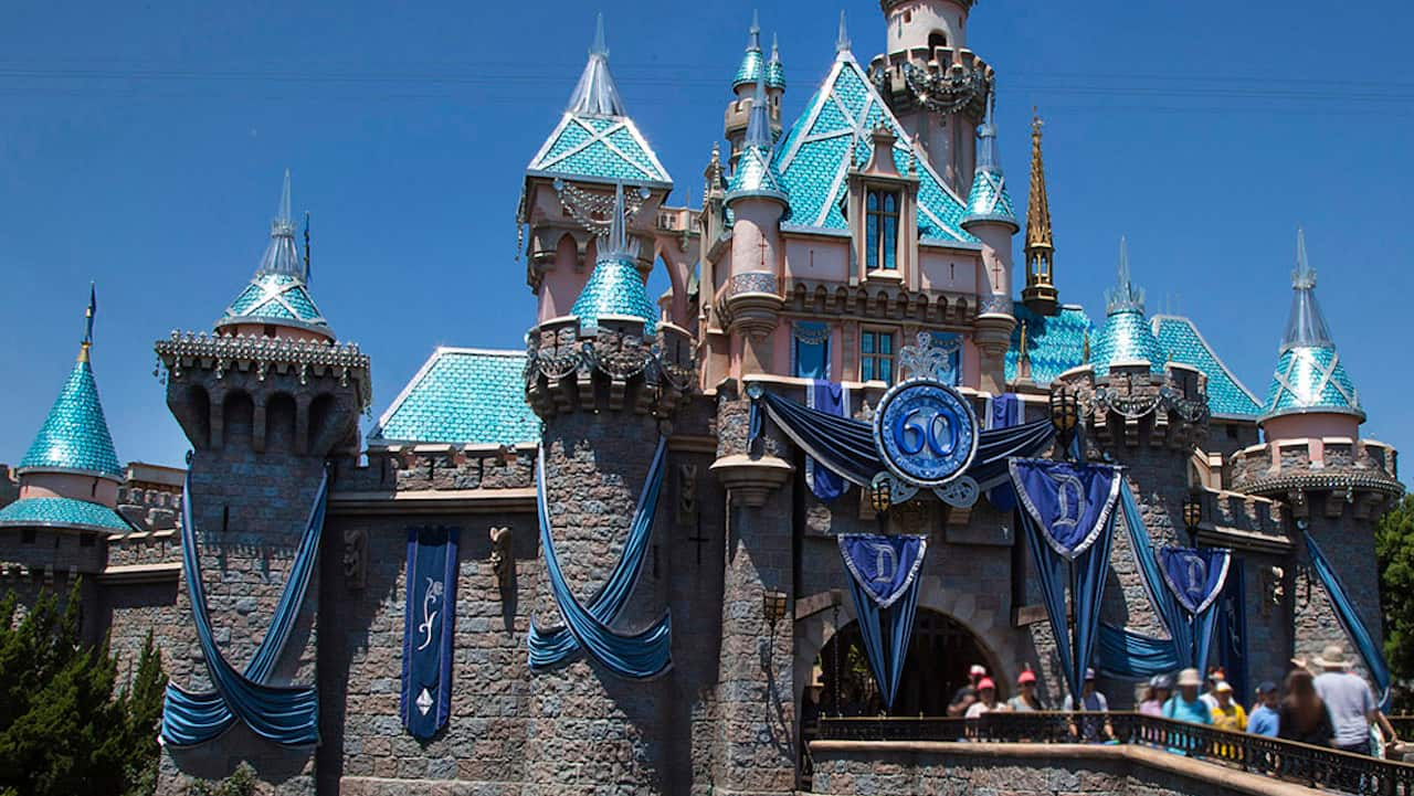 from screen to park sleeping beauty castle at disneyland park