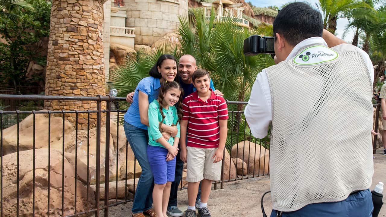 Walt Disney World PhotoPass photographer taking picture of family