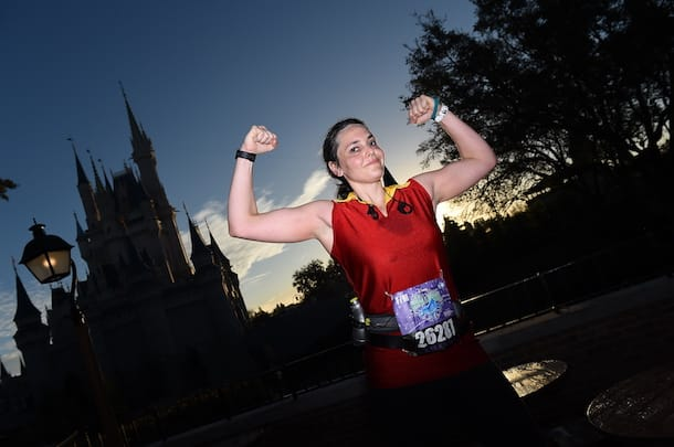 runDisney marathon runner poses in front of Magic Kingdom Park