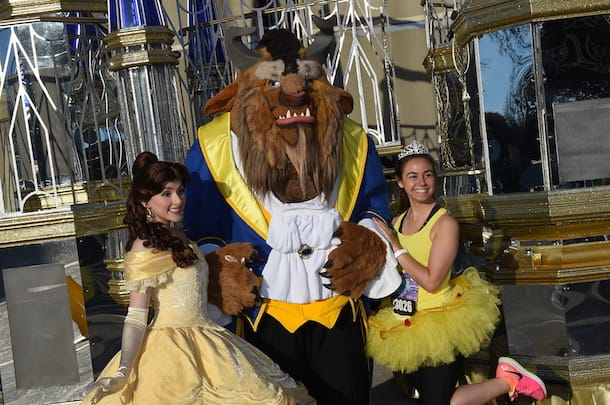 Beast and Belle from the Beauty and the Beast pose with runDisney Marathon runner