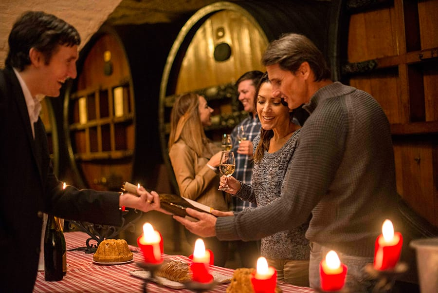 Couple enjoys a visit to a wine cave on an Adventures by Disney food and wine themed river cruise