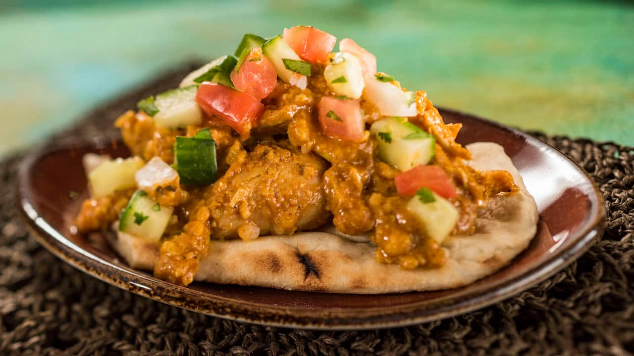 Korma Chicken with Cucumber Tomato Salad, Almonds, Cashews, and Warm Naan Bread