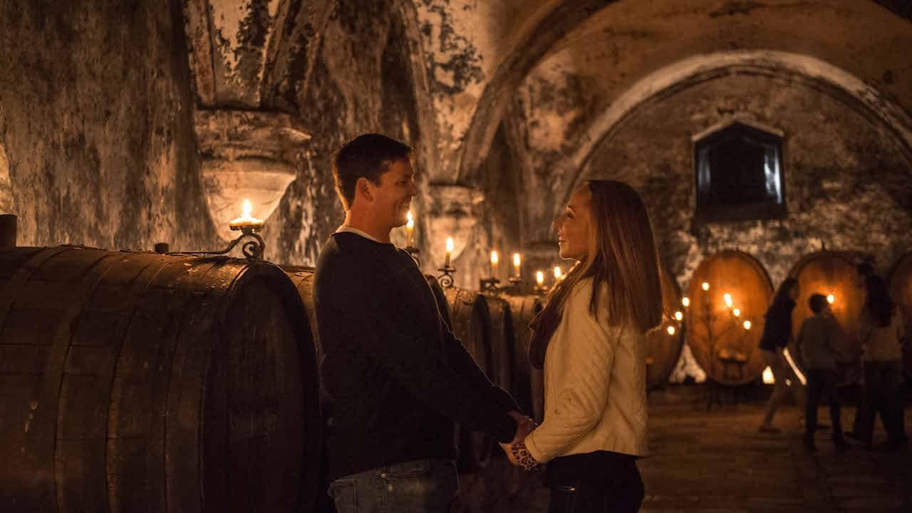 Couple exploring a wine cellar