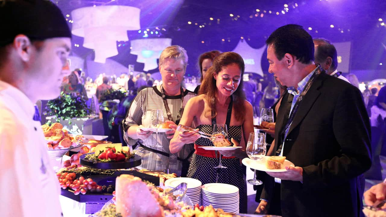 2017 Party for your Senses guests eating and being served food