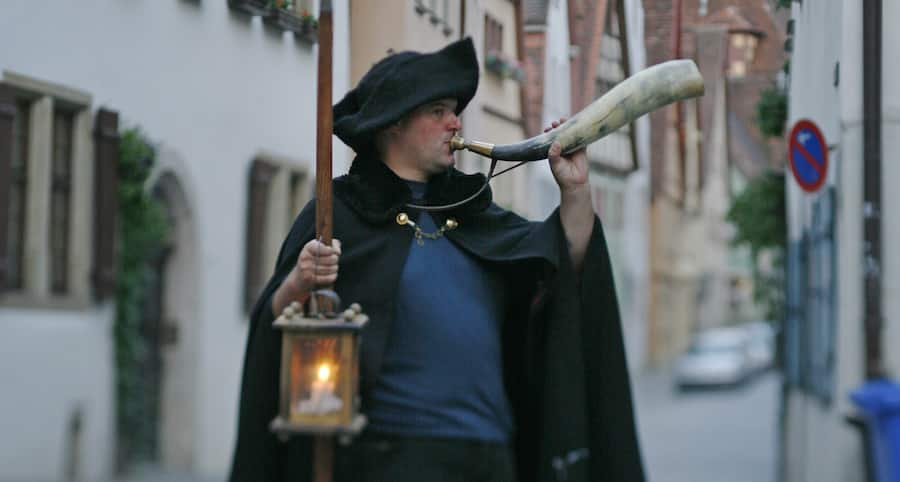 Tour guide with latern in Rothenburg, Germany