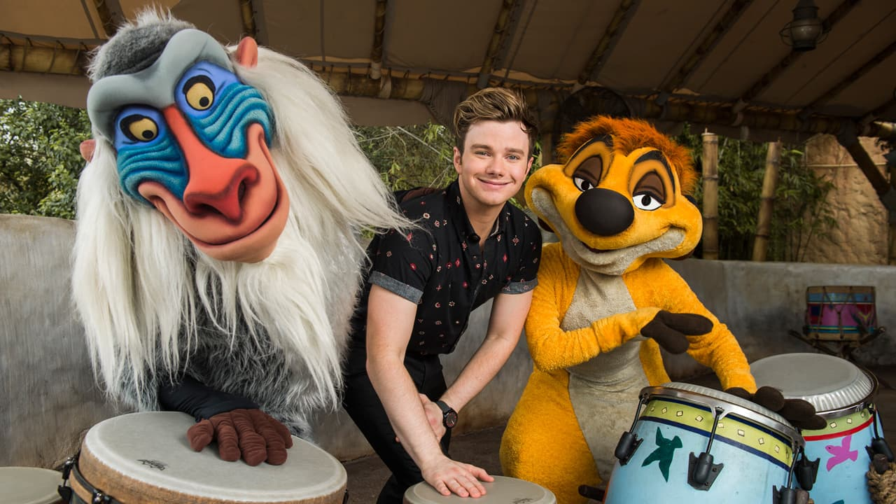 Chris Colfer with Rafiki and Timon at Walt Disney World
