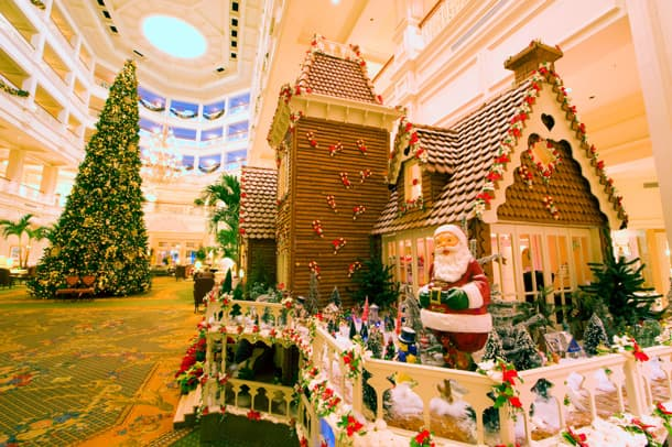 gingerbread house and christmas tree at disneys grand floridian resort spa