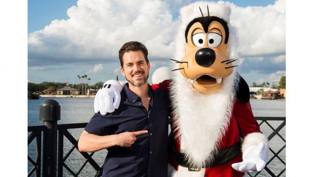 Matt Bomer with Santa Goofy at Epcot