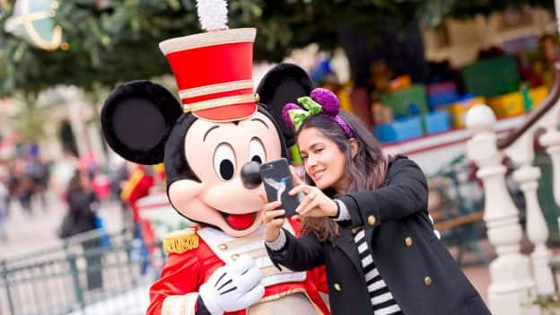 Salma Hayak takes a photo with Mickey Mouse at Disneyland Paris