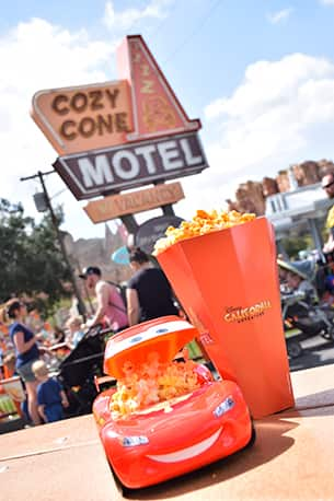 Flavored Popcorn and Lightning McQueen Souvenir Popcorn Bucket at Cozy Cone Motel in Disney California Adventure Park