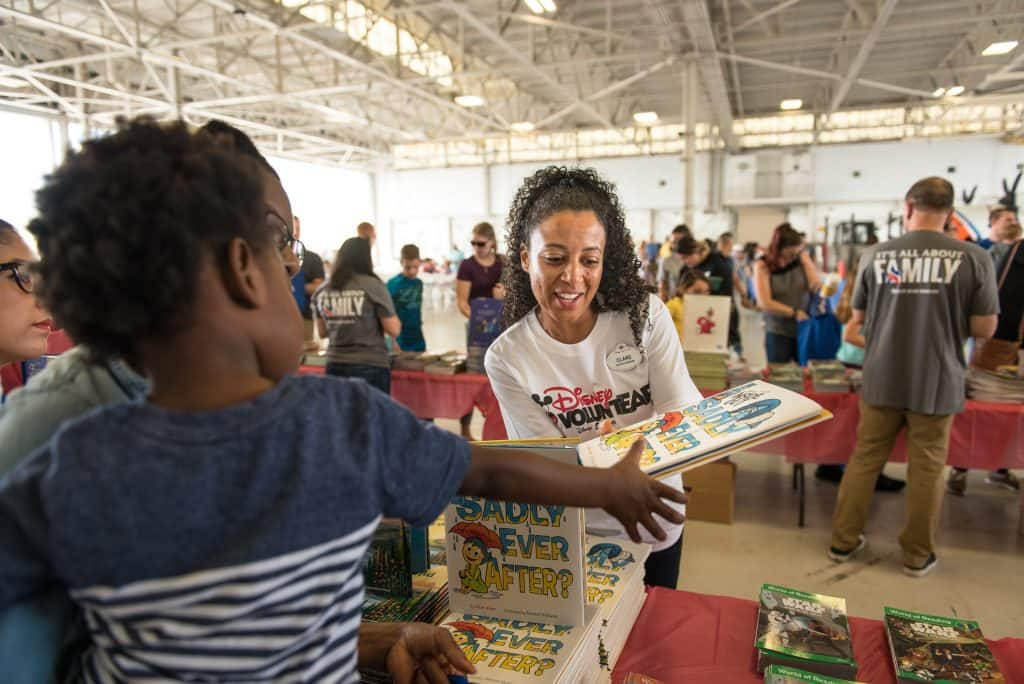 Clare Fox was one of several crew members helping with book distribution.