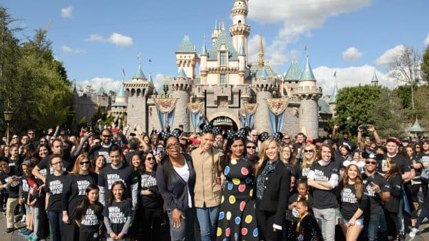A Wrinkle in Time Cast in front of Sleeping Beauty Castle