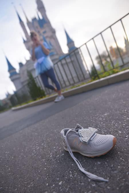 Silver running shoe with Cinderella-inspired shoe decoration