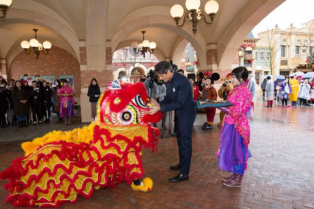 General manager of Shanghai Disney Resort, Philippe Gas, dots the eyes of two lions during a traditional lion dance in celebration of Chinese New Year