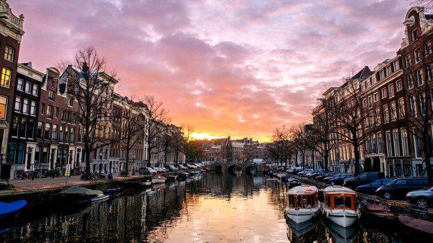 Enjoy a canal ride through The Netherlands on the Adventures by Disney Rhine river cruise