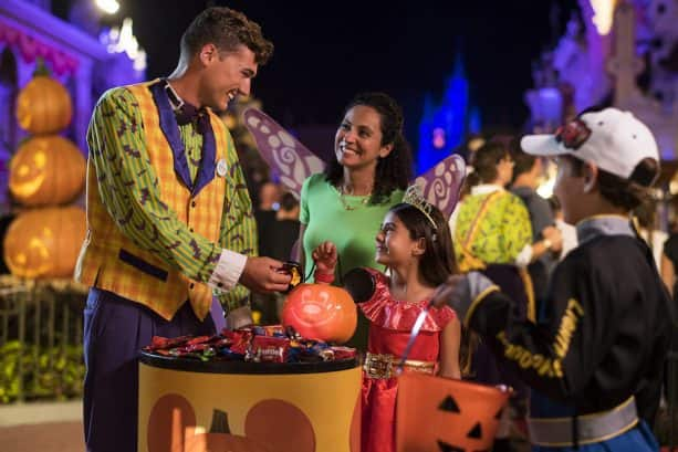 cast member giving out candy at mickeys not so scary halloween party at magic