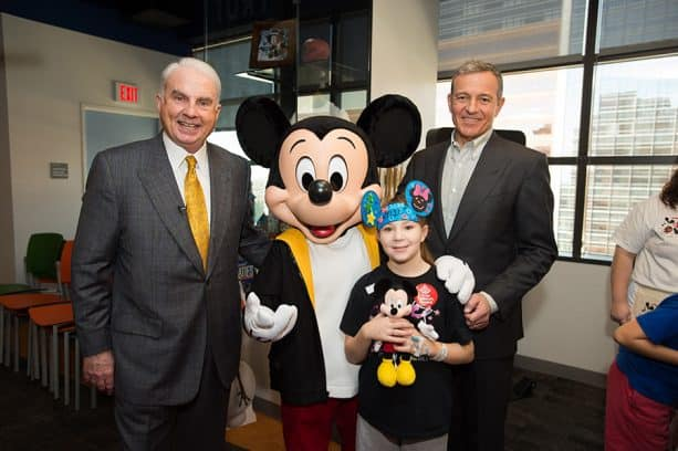 Disney Chairman and CEO Robert A. Iger and Mark A. Wallace, President and CEO of Texas Children's Hospital joined by Mickey Mouse at Texas Children's Hospital
