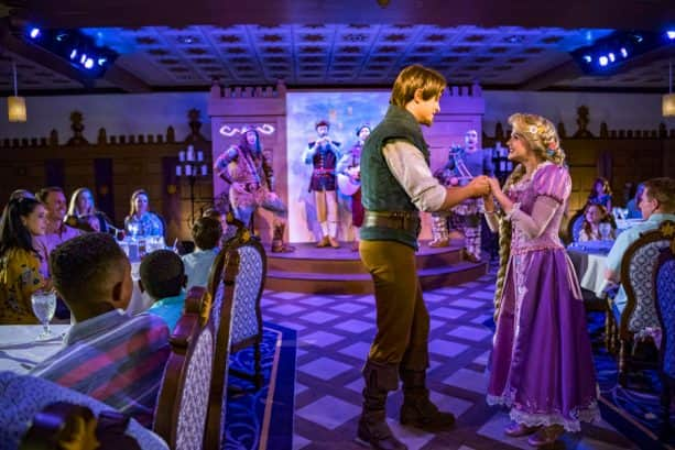 Rapunzel and Flynn Rider dance at Rapunzel's Royal Table restaurant aboard the Disney Magic