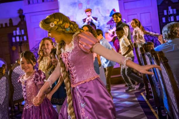 Rapunzel dances with guests at Rapunzel's Royal Table restaurant aboard the Disney Magic