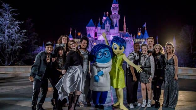 """'American Idol' Top 10 contestants pose with Joy and Sadness from """"Inside Out"""" at Disneyland Park"""