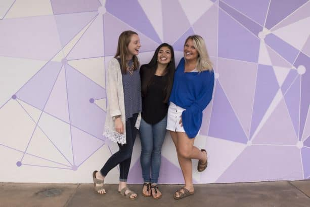 Friends at the 'Purple Wall' at Magic Kingdom Park