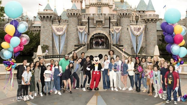 """""""Disney Channel GO"""" fans pose with Mickey Mouse, Disneyland park"""