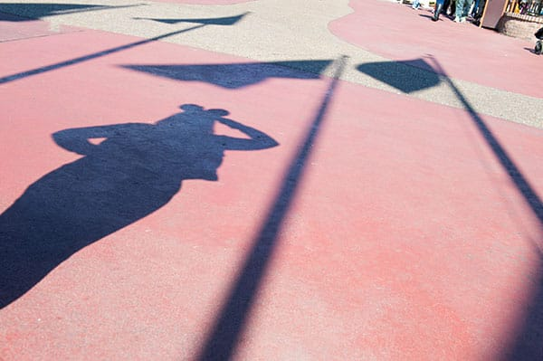 Shadows of people, American flag, Walt Disney World Resort