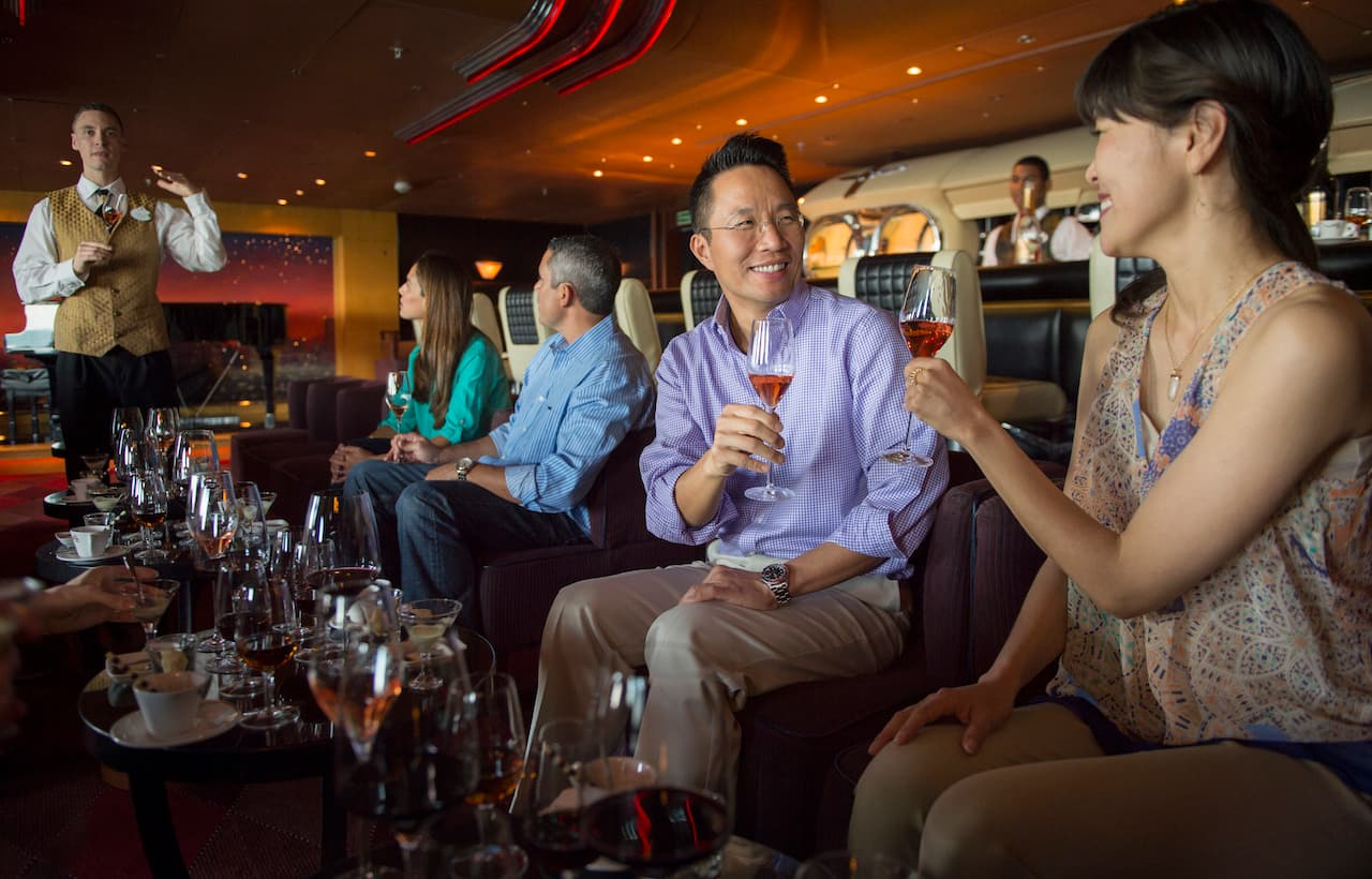 Audlts attending a beverage tasting aboard Disney Cruise Line