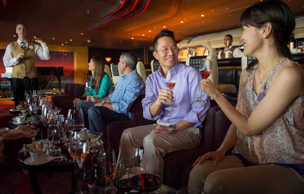 Audlts attending a beverage tasting aboard Disney Cruise Line
