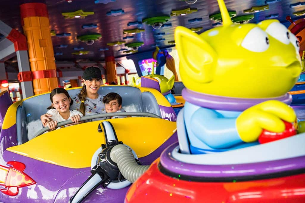 Gaby Espino rides Alien Swirling Saucers at Toy Story Land with her kids, Oriana and Nickolas