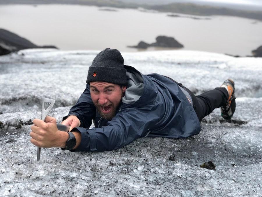 Traveler taking photo on Skaftafell Glacier on Adventures by Disney Iceland Vacation