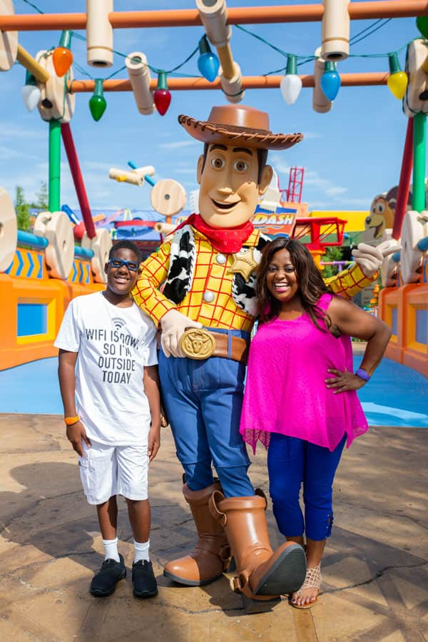 Sherri Shepherd and her son Jeffrey pose with Woody in Toy Story Land at Disney's Hollywood Studios