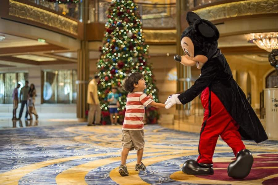 Mickey Mouse and Child abroad the Disney Dream