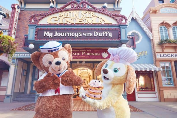 Cookie and Duffy pose outside 'Main Street Cinema: My Journeys with Duffy -- Presented by Fujifilm'