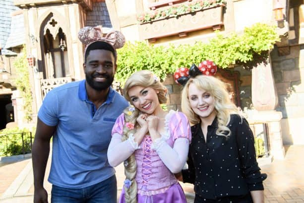 Evanna Lynch and her 'Dancing With the Stars' partner Keo Motsepe with Rapunzel at Disneyland park