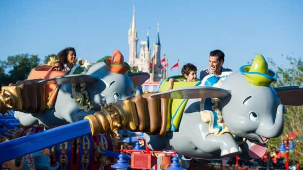 Family enjoying Walt Disney World's Dumbo the Flying Elephant ride
