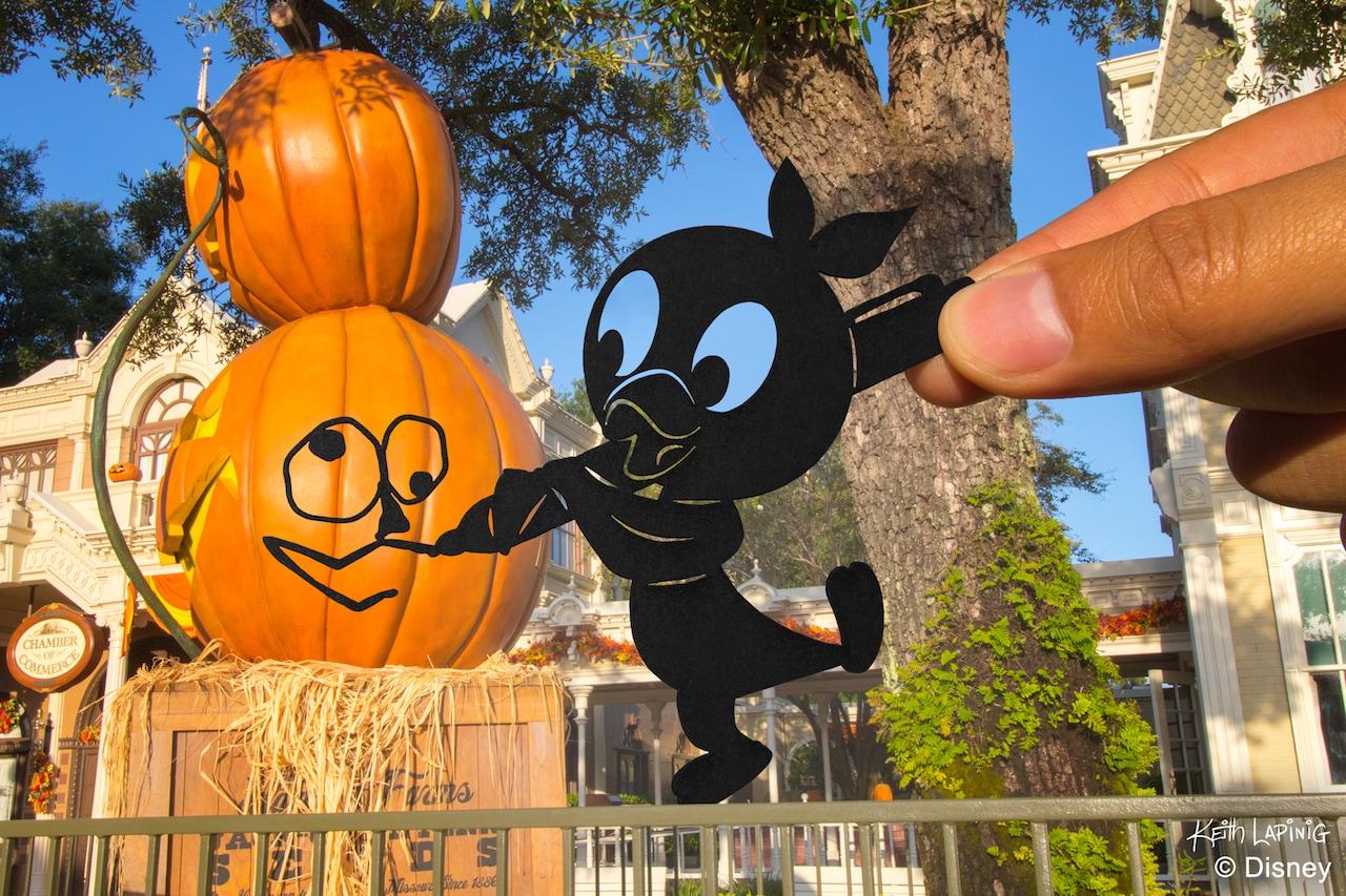 Orange Bird Silhouette helping with decorating Main Street for Halloween