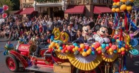 Mickey and Minnie joined a flurry of Disney characters for a festive cavalcade down Main Street, U.S.A. at Disneyland park