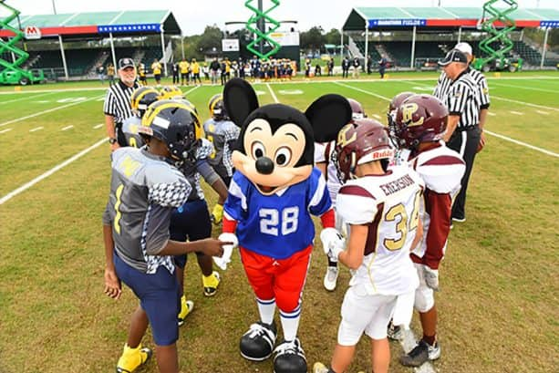 Mickey, and participants of the 2018 Pop Warner Super Bowl