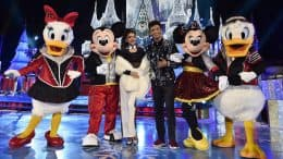 Sarah Hyland and Jordan Fisher pose with Mickey Mouse, Minnie Mouse, Daisy Duck and Donald Duck at Magic Kingdom Park